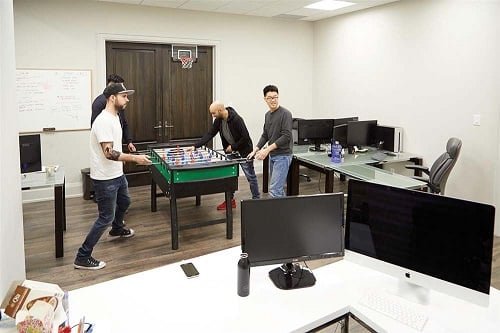 Startup Men Playing Foosball