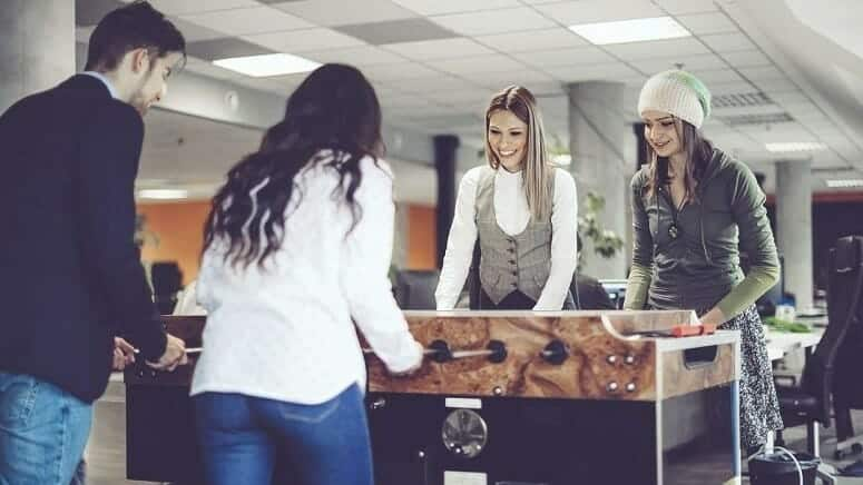 Millennials Playing Foosball At Office