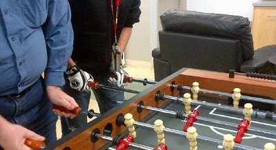 Man using foosball gloves.