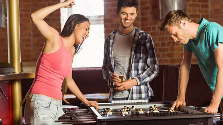 Woman Winning In Foosball