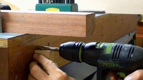 Using a drill to make a table.